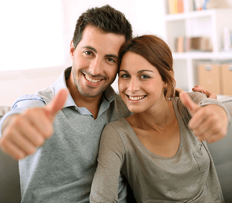 Couple holding Thumbs up | Avalon Dental Care in an Award Winning Dentist in El Segundo and Carson by TopDocLA.com
