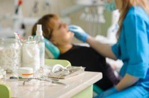 Woman getting teeth exam by a dentist   Avalon Dental, your Carson and El Segundo Dentist