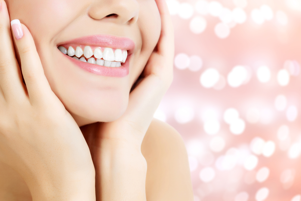 Image of a woman with a sparkling white smile | Avalon Dental, your Carson and El Segundo Dentist