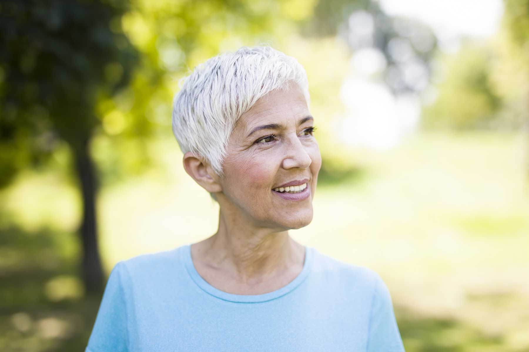 Elderly woman outside | Dentures with Dental Implants?